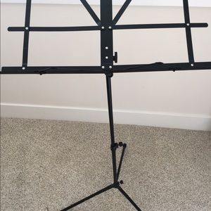 Collapsible music stand in carrier case.